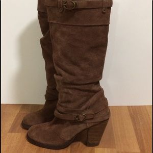 Steve Madden brown leather boots.